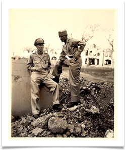 Amidst the rubble of Manila, Ed stands with Major John Boone, one of his commanders.  Both received the Distinguished Service Cross from MacArthur on June 13, 1945